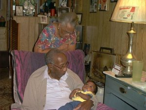 My maternal grandparents meeting the last great-grandchild born before they passed within a year of each other.